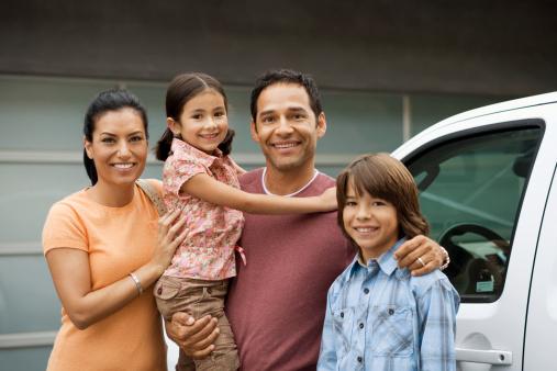 Family beside truck