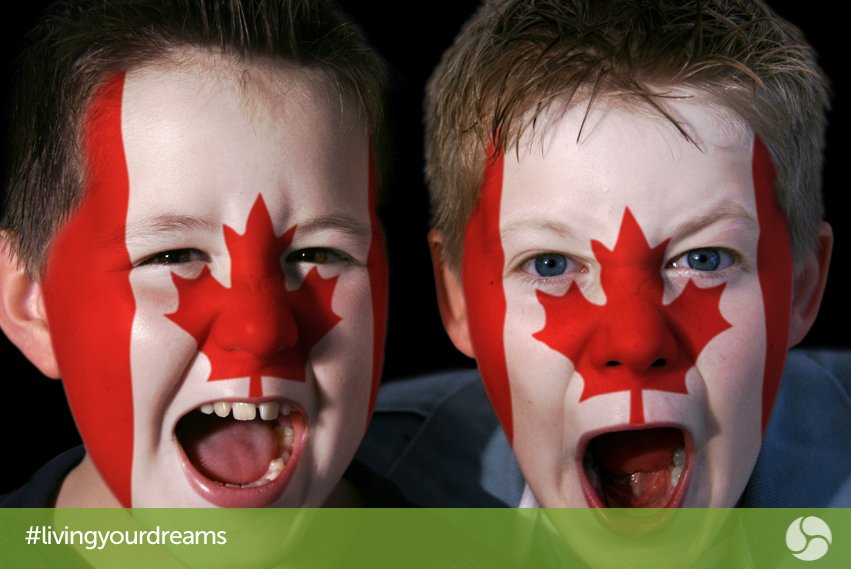 Two boys with Canadian flag face paint