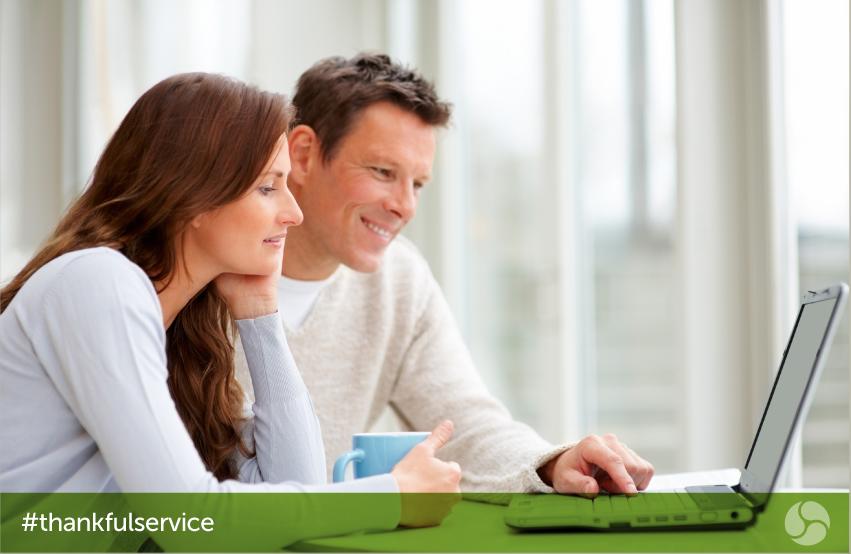 Couple viewing laptop screen