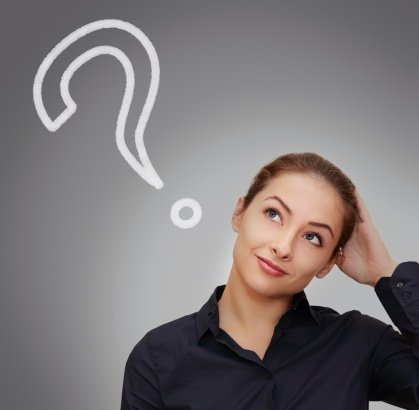 Woman looking at a question mark