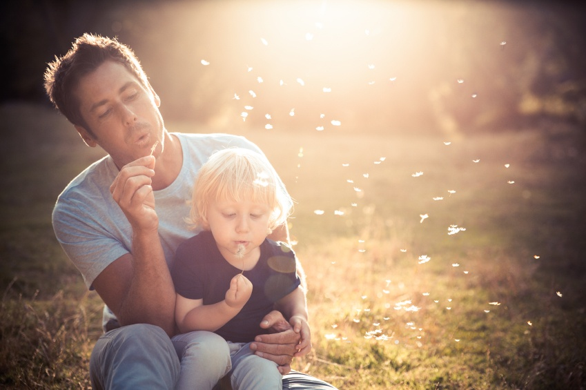 Father and Child Blowing Bubbles