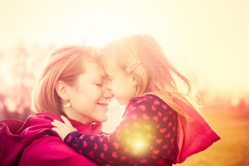 Child kissing mom
