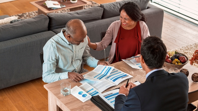 Couple planning with financial advisor.
