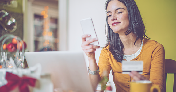 Young woman online holiday shopping